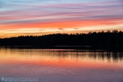 Orange and red sunset mirroring in the water